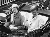 Queen Margrethe of Denmark waving as she rides in an open carriage with Queen Elizabeth II on their way to Royal Ascot England June 17th 1980