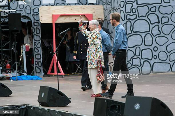 Queen Margrethe waves to the scouts from the FDF summer camp stage after her official opening speech for the camp in Ry Denmark on July 7 2016 Before...