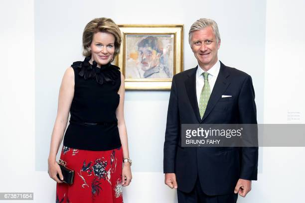 Queen Mathilde and King Philippe Filip of Belgium pose in front of the painting 'Portrait of Rik ' during a visit to the exhibition of Belgian...