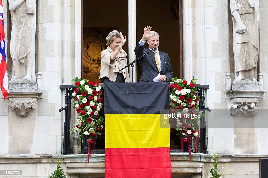 Queen Mathilde (L) and King Philippe of Belgium give a speech during the 'Joyous Entry' of the Belgian royal couple to present themselves to the public in Bruges, on October 25, 2013.