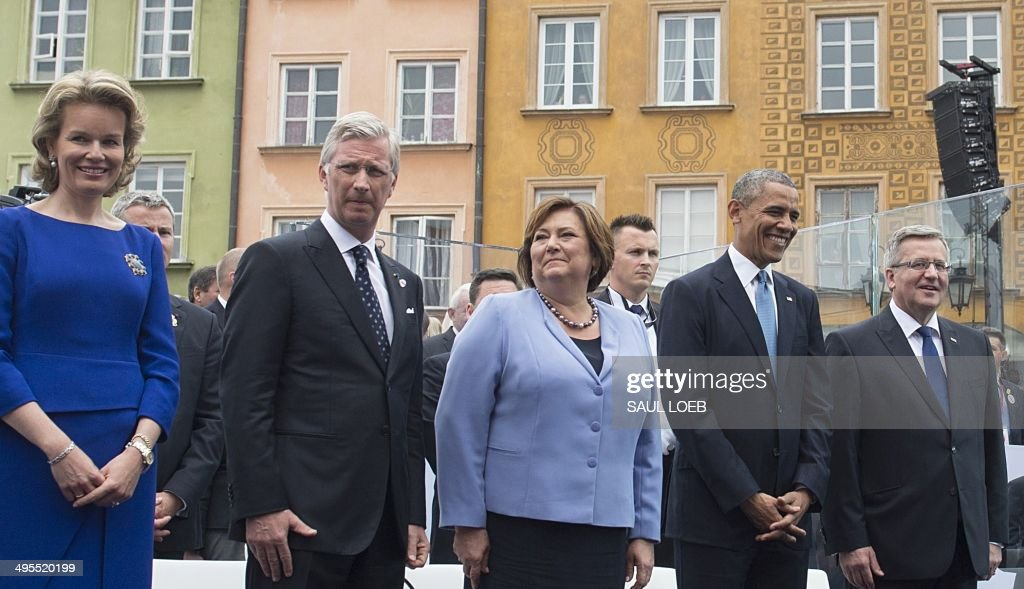 Queen Mathilde and King Philippe of Belgium, Poland's First Lady Anna Komorowka, US President Barack Obama and Polish President Bronislaw attend the 25th Anniversary Freedom Day Event in honor of the 25th anniversary of the first partly-free parliamentary elections in the Royal Square in Warsaw, Poland, on June 4, 2014. AFP PHOTO / Saul LOEB
