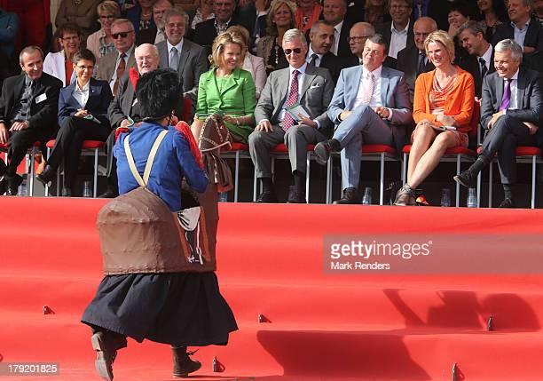 Queen Mathilde and King Philippe of Belgium watch during the Hanswijck's Calvade on September 1 2013 in Mechelen Belgium