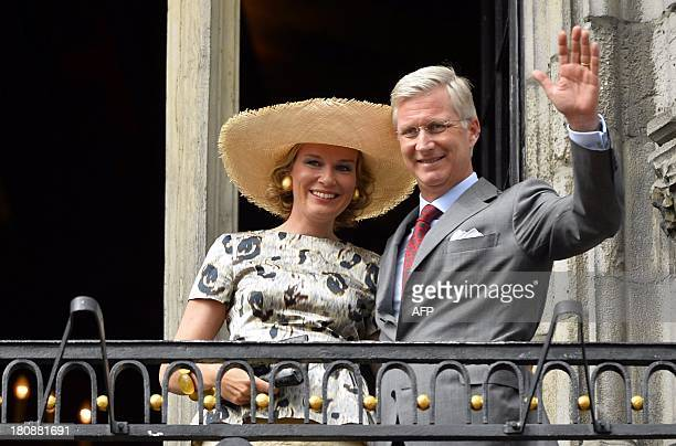 Queen Mathilde of Belgium and King Philippe Filip of Belgium greet the audience from the balcony during the 'Joyous EntryBlijde IntredeJoyeuse...