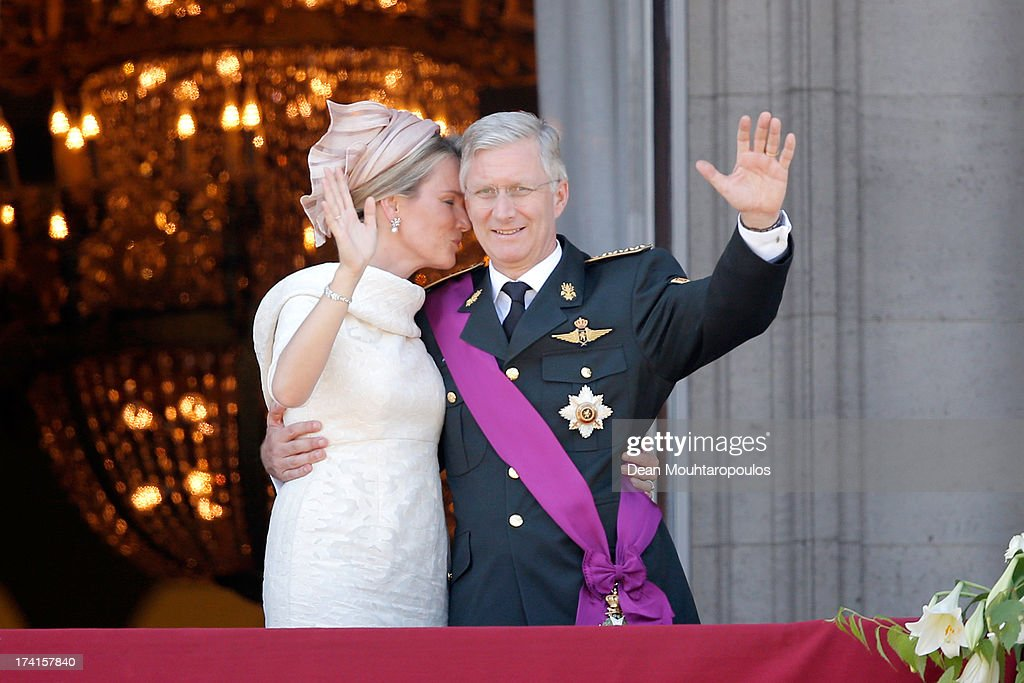 Queen Mathilde of Belgium and King Philippe of Belgium are seen greeting the audience from the balcony of the Royal Palace during the Abdication Of King Albert II Of Belgium, & Inauguration Of King Philippe on July 21, 2013 in Brussels, Belgium.