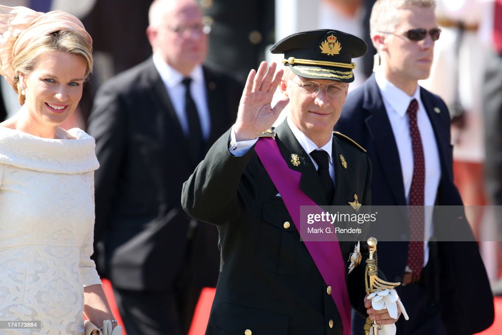 Queen Mathilde of Belgium and King Philippe of Belgium attend the Civil and Military Parade during the Abdication Of King Albert II Of Belgium, & Inauguration Of King Philippe on July 21, 2013 in Brussels, Belgium.