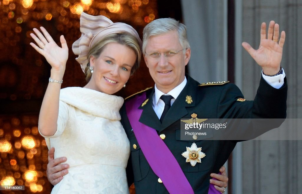 Queen Mathilde of Belgium and King Philippe of Belgium greet the audience from the balcony of the Royal Palace during the Abdication Of King Albert II Of Belgium & Inauguration Of King Philippe on July 21, 2013 in Brussels, Belgium.