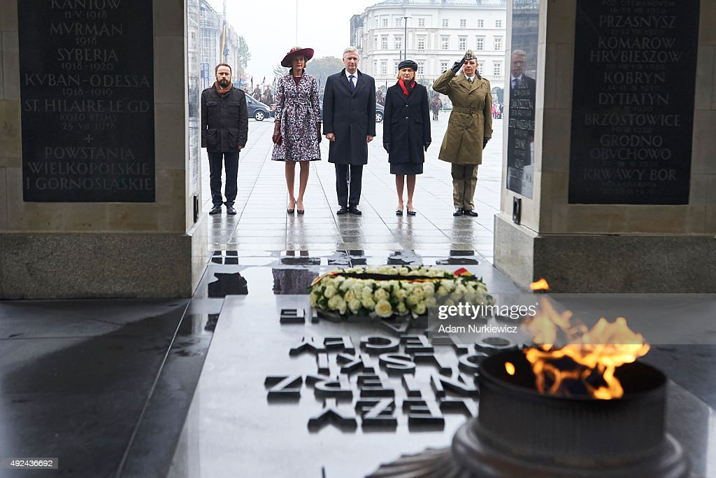 Queen Mathilde of Belgium and King Philippe of Belgium visit the Tomb of the Unknown Soldier as part of official Royal visit in Poland on October 13, 2015 in Warsaw, Poland.