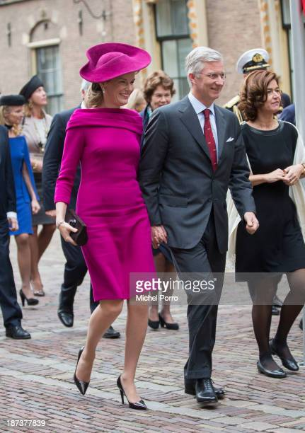 Queen Mathilde of Belgium and King Philippe of Belgium walk across the Binnenhof Parliament Square during an official visit to The Netherlands on...