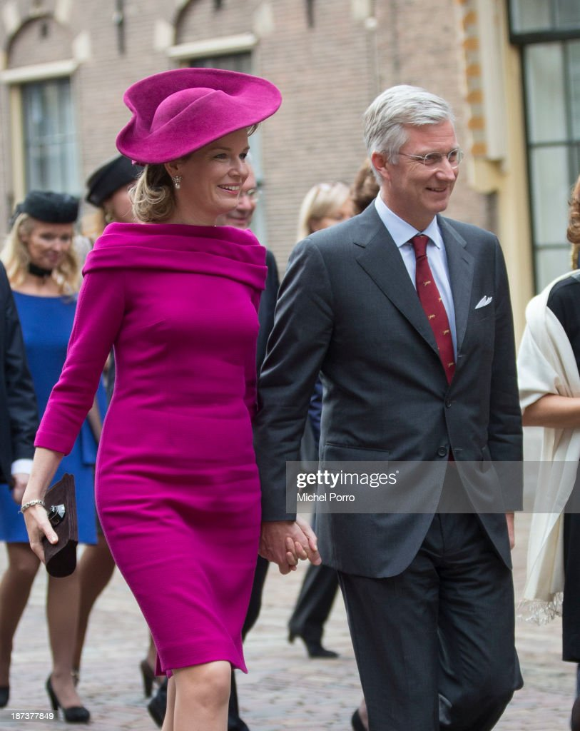 <a gi-track='captionPersonalityLinkClicked' href=/galleries/search?phrase=Queen+Mathilde+of+Belgium&family=editorial&specificpeople=239189 ng-click='$event.stopPropagation()'>Queen Mathilde of Belgium</a> and King <a gi-track='captionPersonalityLinkClicked' href=/galleries/search?phrase=Philippe+of+Belgium&family=editorial&specificpeople=160209 ng-click='$event.stopPropagation()'>Philippe of Belgium</a> walk across the Binnenhof Parliament Square during an official visit to The Netherlands on November 8, 2013 in The Hague, Netherlands.