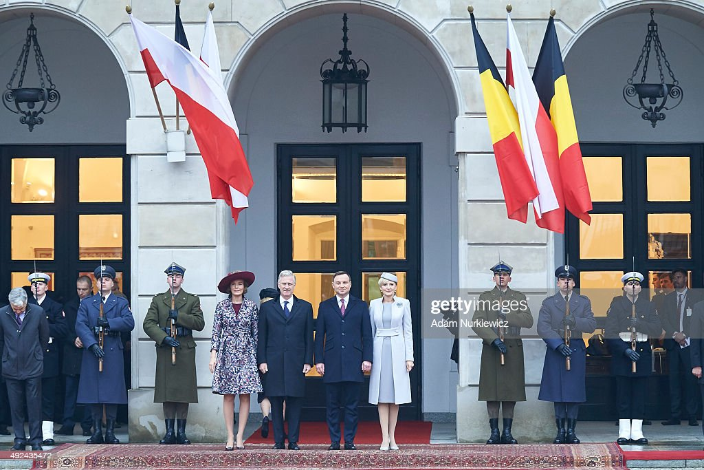 Queen Mathilde of Belgium and King Philippe of Belgium with Polish President Andrzej Duda and Polish First Lady Agata Kornhauser-Duda attend the welcoming ceremony at the Presidential Palace as part of official Royal visit in Poland on October 13, 2015 in Warsaw, Poland.