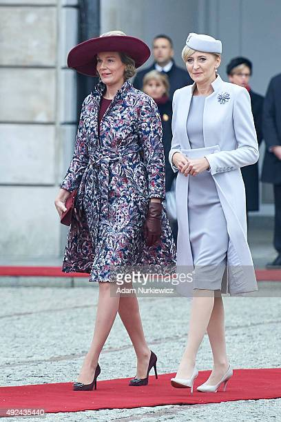 Queen Mathilde of Belgium and Polish First Lady Agata KornhauserDuda attend the welcoming ceremony at the Presidential Palace as part of official...