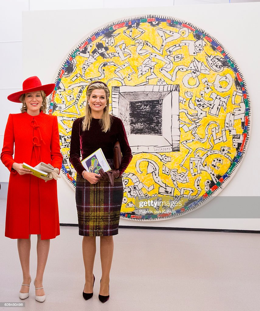 Queen Mathilde of Belgium (L) and Queen Maxima of the Netherlands visit the exhibition Pierre Alechinsky Post Cobra at the Cobra Museum on November 29, 2016 in The Hague, Netherlands.