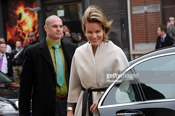 Queen Mathilde of Belgium attends a meeting at the Relais Social de Charleroi on February 11 2014 in Charleroi Belgium