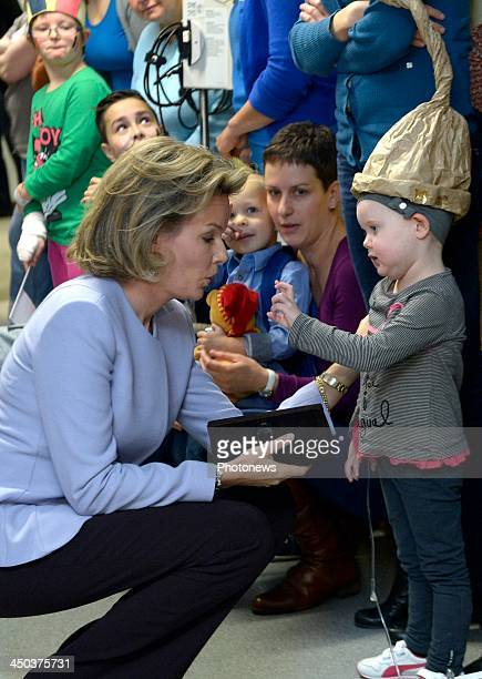 Queen Mathilde of Belgium attends a reading session with children suffering from cancer at the UZ Hospital on November 18 2013 in Leuven Belgium