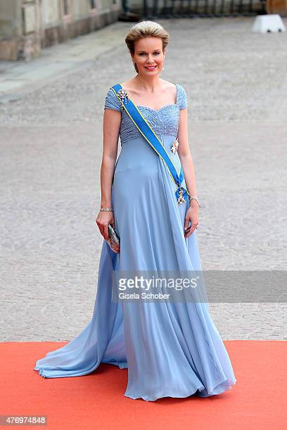 Queen Mathilde of Belgium attends the royal wedding of Prince Carl Philip of Sweden and Sofia Hellqvist at The Royal Palace on June 13 2015 in...