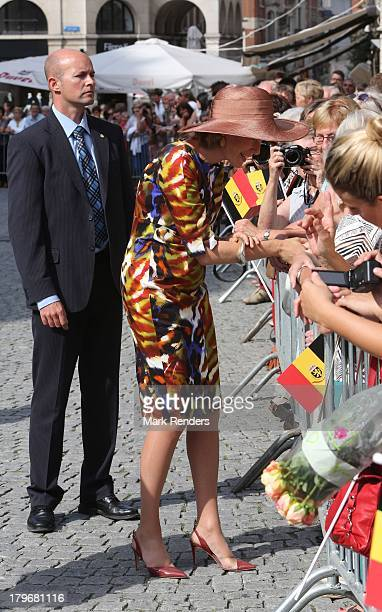 Queen Mathilde of Belgium greets members of the public during her first visit to the city with King Philippe of Belgium known as the 'Joyous Entry'...