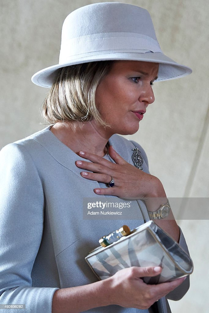 Queen Mathilde of Belgium holds handbag while her visit The Museum of the History of Polish Jews as part of official Royal visit in Poland on October 14, 2015 in Warsaw, Poland.