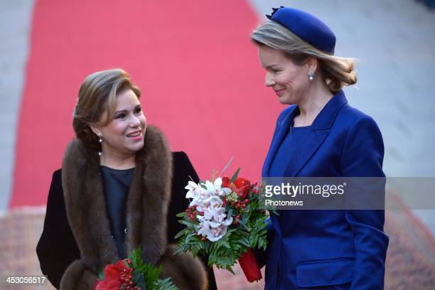 Queen Mathilde of Belgium is accompanied by Grand Duchess Maria Teresa of Luxembourg during a welcome ceremony for the Beglgian royal couple at Grand...