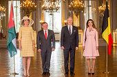 Queen Mathilde of Belgium King Abdullah II of Jordan King Philippe of Belgium and Queen Rania of Jordan pose for the official photo at the Royal...