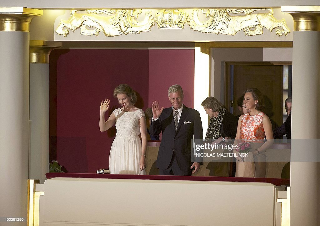 Queen Mathilde of Belgium, King Philippe - Filip of Belgium and Princess Claire of Belgium wave to the audience during the final concert of the Queen Elisabeth Singing Competition 2014 at the Brussels' Flagey hall, on June 10, 2014, in Brussels. AFP PHOTO / BELGA / NICOLAS MAETERLINCK Belgium Out