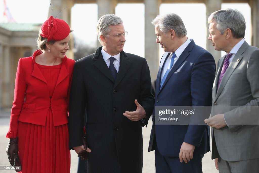 Queen Mathilde of Belgium, King Philippe of Belgium, Berlin Mayor <a gi-track='captionPersonalityLinkClicked' href=/galleries/search?phrase=Klaus+Wowereit&family=editorial&specificpeople=213527 ng-click='$event.stopPropagation()'>Klaus Wowereit</a> and Belgian Foreign Minister <a gi-track='captionPersonalityLinkClicked' href=/galleries/search?phrase=Didier+Reynders&family=editorial&specificpeople=548982 ng-click='$event.stopPropagation()'>Didier Reynders</a> stand in front of the Brandenburg Gate on Pariser Platz on February 17, 2014 in Berlin, Germany. King Philippe and Queen Mathilde are in Berlin to attend a German-Belgian conference.