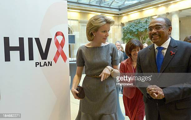 Queen Mathilde of Belgium launches the HIV national plan as she walks with Michel Sidibe on October 15 2013 in Brussels Belgium