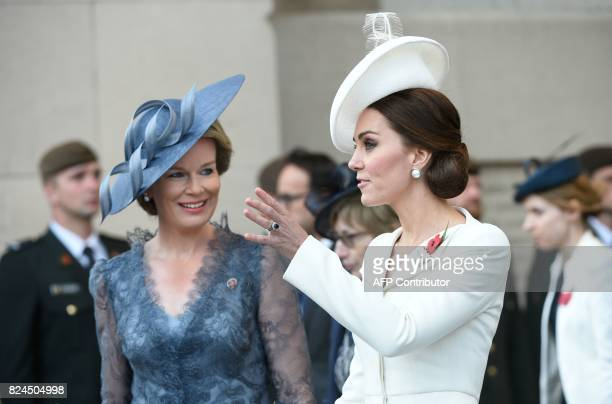 Queen Mathilde of Belgium listens to Britain's Catherine Duchess of Cambridge as they attend a ceremony marking the centenary of the battle of...