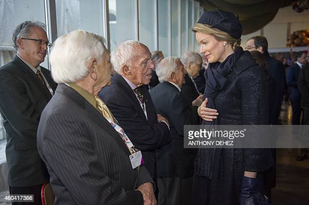 Queen Mathilde of Belgium meets US veterans on December 13 in Bastogne during a ceremony marking the 70th anniversary of the Battle of the Bulge The...
