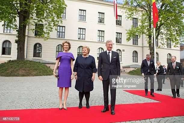 Queen Mathilde of Belgium Norwegian Prime Minister Erna Solberg and King Philippe of Belgium pause for a photograph at the Prime Ministers office on...