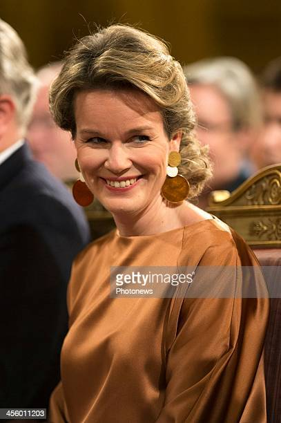 Queen Mathilde of Belgium pose at the Christmas concert held at the Royal Palace on December 11 2013 in Brussels Belgium