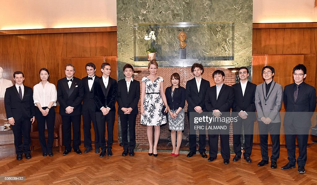 Queen Mathilde of Belgium (C) poses with contestants during the award ceremony of the Queen Elisabeth Piano Competition 2016 at the Queen Elisabeth Music Chapel in Waterloo, on May 31, 2016. / AFP / BELGA / ERIC LALMAND / Belgium OUT