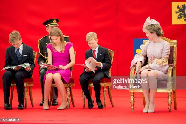 Queen Mathilde of Belgium Princess Elisabeth of Belgium Prince Gabriel of Belgium and Prince Emmanuel of Belgium attend the military parade on the...