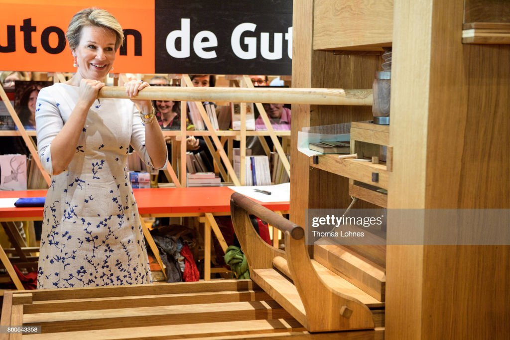 Queen Mathilde of Belgium prints the declaration of the human rights with and an old print press at the pavilion of the French guest of honour at the 2017 Frankfurt Book Fair (Frankfurter Buchmesse) on October 12, 2017 in Frankfurt am Main, Germany. The 2017 fair, which is among the world's largest book fairs, is open to the public from October 11-15.