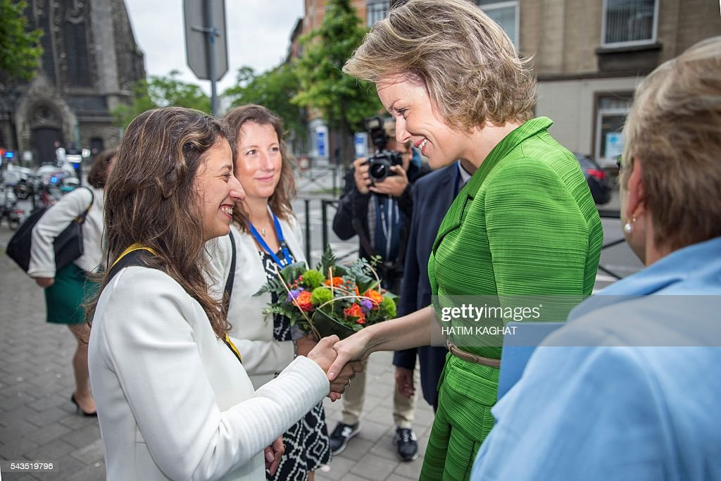 Queen Mathilde of Belgium (R) shakes hand with Anderlecht Alderwoman, Fatiha El Ikdimi during a ceremony for the Federal Poverty Reduction Prize on June 29, 2016 in Brussels. / AFP / Belga / HATIM KAGHAT / Belgium OUT