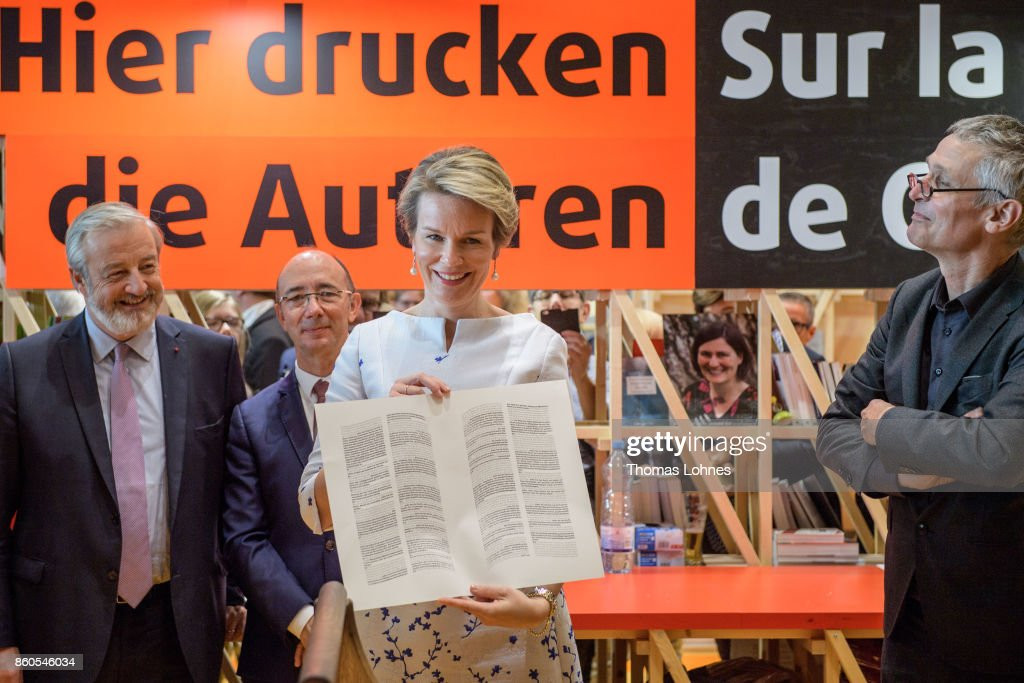 Queen Mathilde of Belgium shows the declaration of the human rights that was printed with an old print press at the pavilion of the French guest of honour at the 2017 Frankfurt Book Fair (Frankfurter Buchmesse) on October 12, 2017 in Frankfurt am Main, Germany. The 2017 fair, which is among the world's largest book fairs, is open to the public from October 11-15.