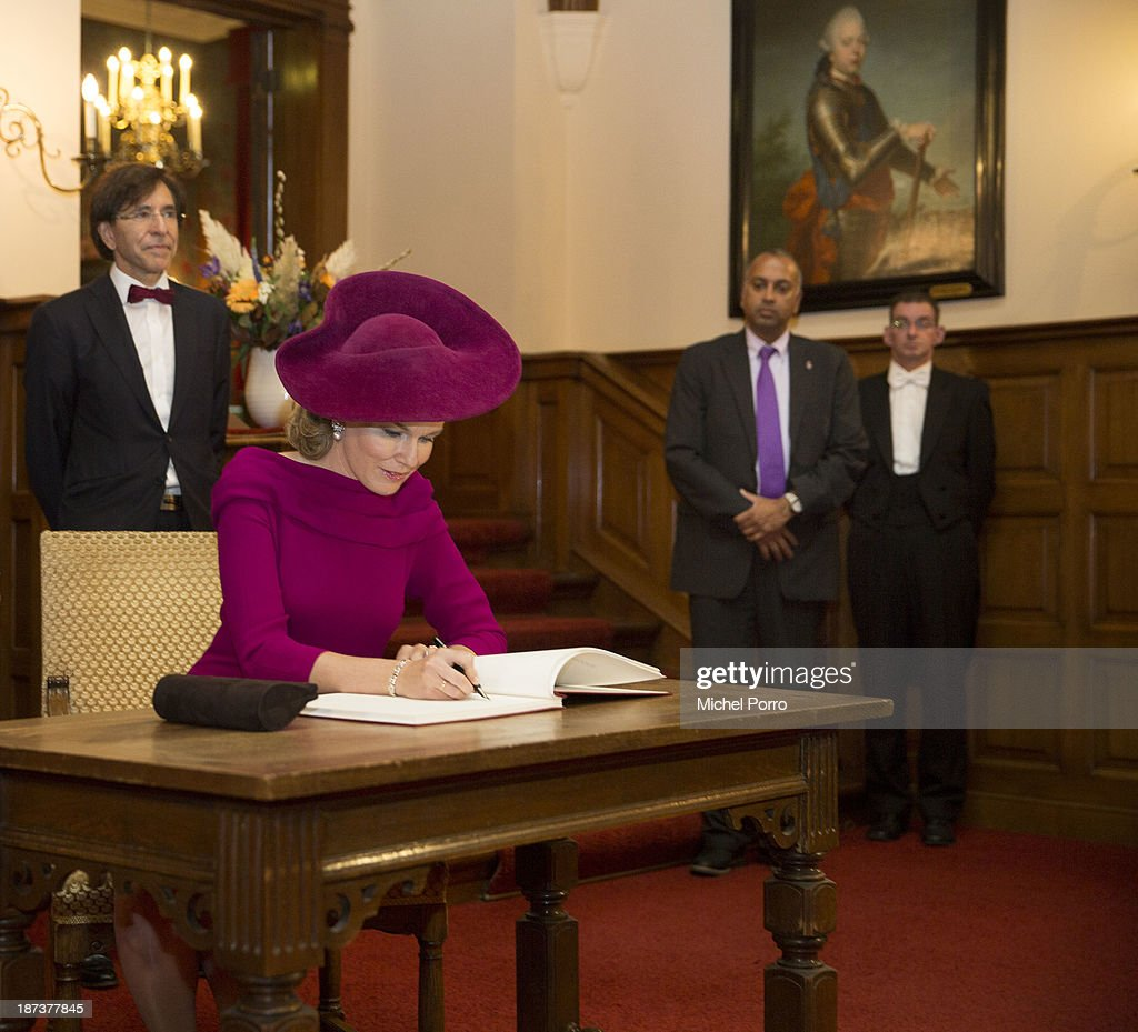 <a gi-track='captionPersonalityLinkClicked' href=/galleries/search?phrase=Queen+Mathilde+of+Belgium&family=editorial&specificpeople=239189 ng-click='$event.stopPropagation()'>Queen Mathilde of Belgium</a> signs the guest book during a tour of the Senate of Parliament during an official visit to The Netherlands. Elio di Rupo looks on. on November 8, 2013 in The Hague, Netherlands.