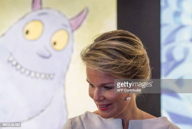 Queen Mathilde of Belgium speaks to publishers at the stand of Belgian publisher Mijade as she visited the Frankfurt Book Fair 2017 in Frankfurt am...