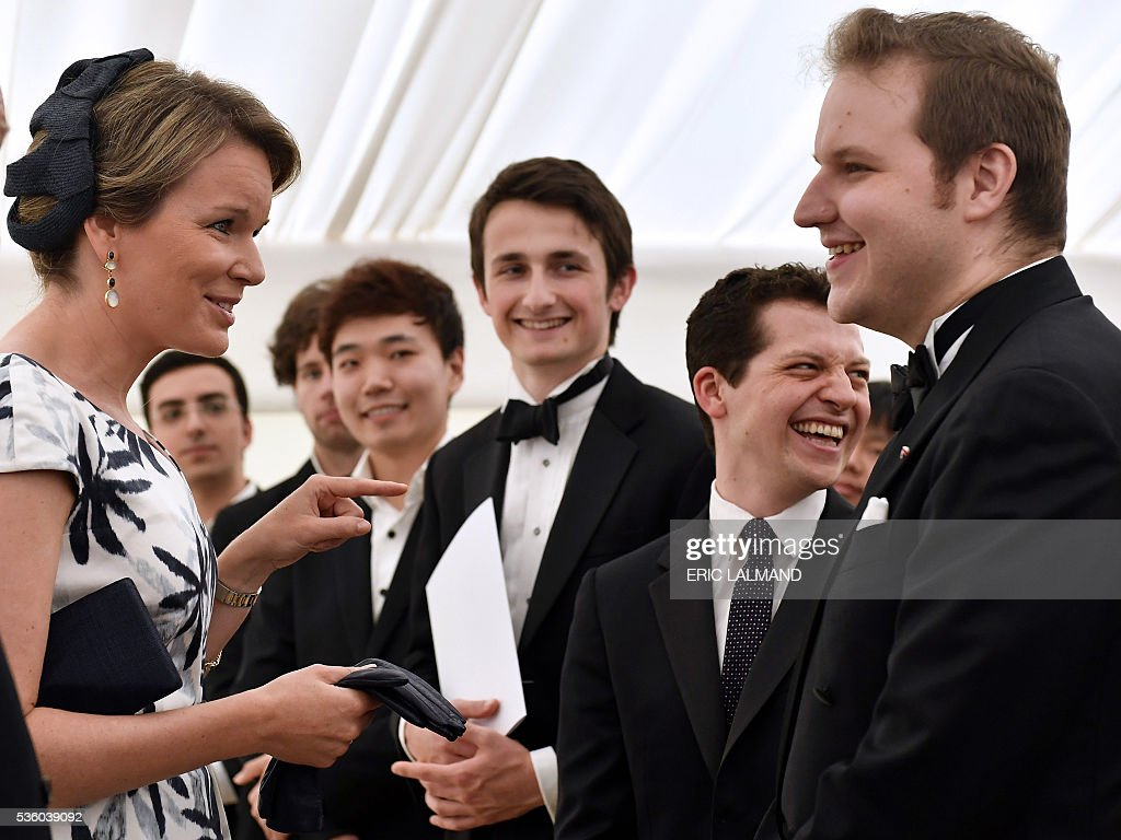 Queen Mathilde of Belgium (L) speaks with Czech contestant Lukas Vondracek (R) during the award ceremony for the laureates of the Queen Elisabeth Piano Competition 2016 at the Queen Elisabeth Music Chapel on May 31, 2016 in Waterloo. / AFP / BELGA / ERIC LALMAND / Belgium OUT