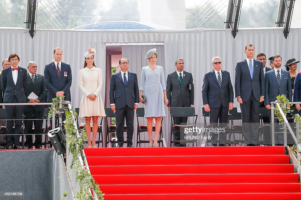 Queen Mathilde of Belgium (C) stands between guests as outgoing Belgian Prime Minister Elio Di Rupo (1st row,2ndL), Britain's Prince William (3rdL), The Duke of Cambridge , Britain's Catherine (Kate), Duchess of Cambridge, (4thL), French President Francois Hollande (5thL), German President Joachim Gauck (8thL) and Spanish King Felipe VI (4thR) at a ceremony at the memorial interallied in Cointe, for the 100th anniversary of the First World War, on August 4, 2014, in Liege. AFP PHOTO BELGA BRUNO FAHY ** Belgium Out **