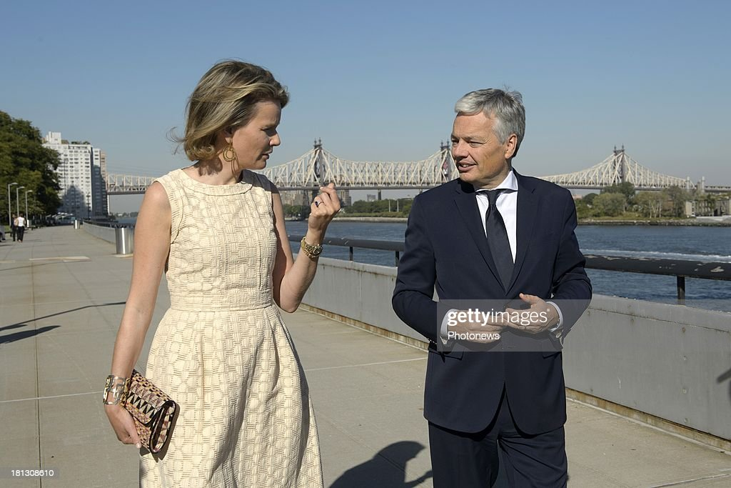 Queen Mathilde of Belgium talks with Didier Reynders, Minister of Foreign Affairs during her visit to New York on September 19, 2013 in New York, USA.
