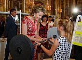 Queen Mathilde of Belgium visits the exhibition on science and culture 'Science et culture au Palais' at the Royal Palace in Brussels on July 20 2016...