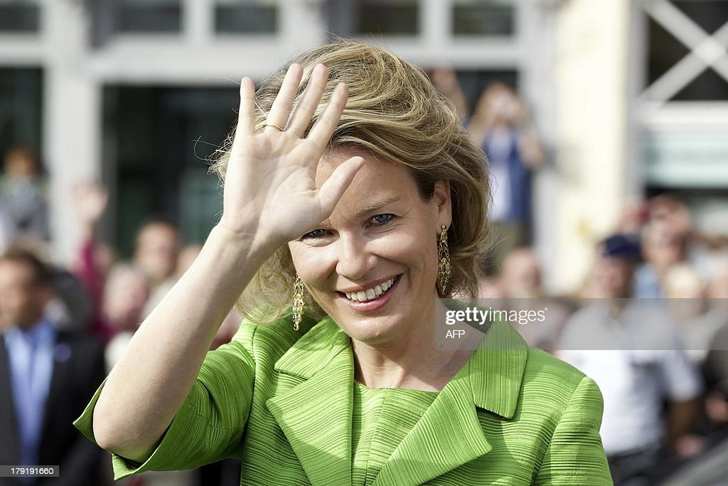 Queen Mathilde of Belgium waves during the 'Hanswijkcavalcade' and 'Ommegang' historical parades in Mechelen on September 1, 2013. The 'Hanswijkcavalcade' parade is organized once every 25 years.