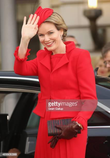 Queen Mathilde of Belgium waves to onlookers as she departs from the Adlon Hotel on February 17 2014 in Berlin Germany King Philippe and Queen...