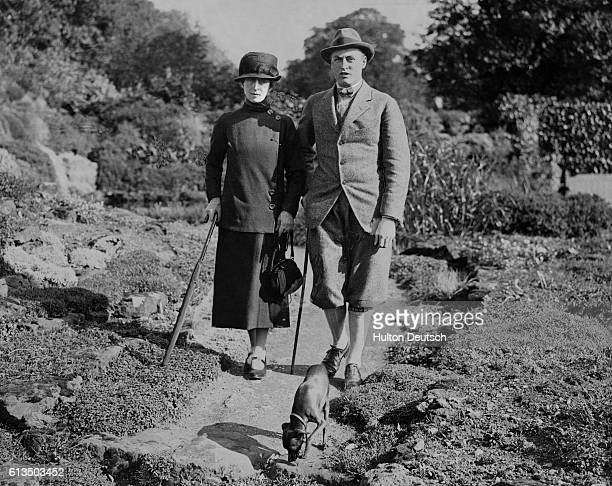 Queen Maud of Norway and her son Prince Olav are in England and staying at Appleton House Kings Lynn The Queen of Norway and Prince Olav walking in...