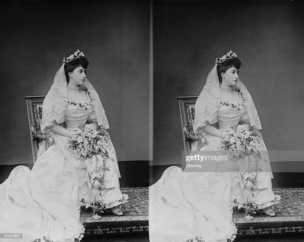 Queen Maud (1869 - 1938), the daughter of the Prince of Wales (later King Edward VII), in her wedding dress, 22nd July 1896. She is marrying her cousin, Prince Carl of Denmark, who ascended the throne of Norway in 1905 as King Haakon VII.