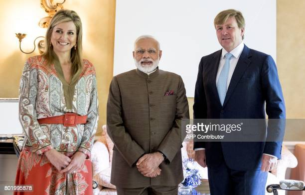 Queen Maxima and King Willem Alexander of the Netherlands pose for a photograph with Indian Prime Minister Narendra Modi at Villa Eikenhorst in...