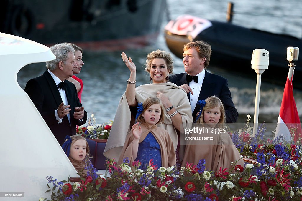 Queen Maxima (L) and King Willem Alexander (R) of The Netherlands with daughters Princess Alexia and Princess Catharina-Amalia are seen aboard the King's boat for the water pageant to celebrate the inauguration of King Willem Alexander of the Netherlands after the abdication of his mother Queen Beatrix of the Netherlands on April 30, 2013 in Amsterdam, Netherlands.