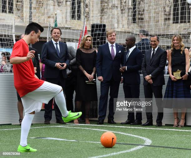 Queen Maxima and King WillemAlexander of The Netherlands and Clarence Seedorf attend a football clinic for integration organized by Italian Football...