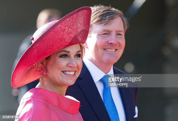Queen Maxima and King WillemAlexander of the Netherlands arrive in front of the Alte Pinakothek museum in Munich southern Germany on April 13 2016...