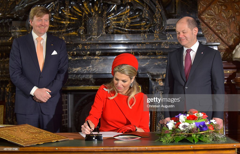 Queen Maxima and King Willem-Alexander of The Netherlands attend by mayor Olaf Scholz sign the golden book of the city of Hamburg at the townhall of Hamburg on March 20, 2015 in Hamburg, Germany.